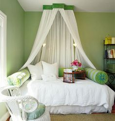 This chic guest bedroom gets a little drama with a soft, flowing canopy, hung from a painted green crown. #interior decorating @reduxvirtualdes