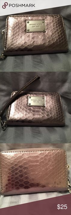 Michael Kors wristlet Super cute, gently used gunmetal wristlet with 3 card slots on one side and a slot on the other side. Make me your best offer. MICHAEL Michael Kors Bags Clutches & Wristlets