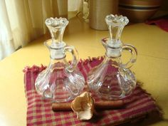 """Perfect pair of vintage Anchor Hocking Cruets    This set is marked with Anchor Hocking hallmark on the bottom of each cruet. They measure about 5 1/2"""" with the stopper in cruet. They measure about 3 1/2"""" in diameter.    These are from about the c70"""