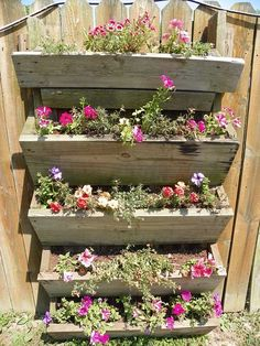 Just put a back on the steps, flipped it upside down and attached to fence.  I already have an old set from a contractor friend. Plan to relocate my strawberries. Mix in some DE to kill slugs who tagged along and rabbits cannot climb.