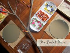The Beaded Branch: Decorating a tree branch with wooden beads and yarn. A very engaging project for toddlers and preschoolers. {from An Everyday Story}