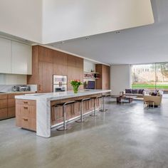 Kitchen Lazenby - Decorative Concrete Sectors A Guide on Switching Birth Control Pills Keywords: swi Concrete Tiles Kitchen, Light Wood Cabinets, Kitchen Flooring, Concrete Kitchen Floor, Concrete Interiors, Kitchen Interior, Concrete Floors Living Room, Concrete Decor, Modern Kitchen Design