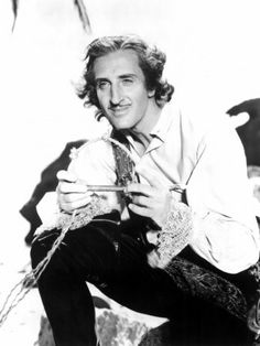 Sir Basil Rathbone; I also loved his freewheeling Capt. Levasseur in Capt. Blood. What a happily bad boy.