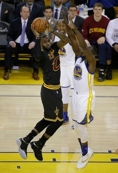 Cleveland Cavaliers forward LeBron James looks to pass next to Golden State Warriors forward Draymond Green, right, during the first half of Game 7 of basketball's NBA Finals in Oakland, Calif., Sunday, June 19, 2016. (AP Photo/Eric Risberg)