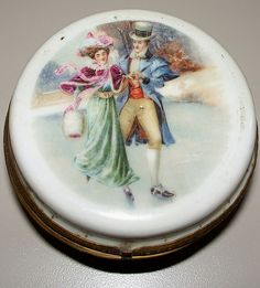 Antique KPM Small Porcelain Dresser Jar ~ Depicts ice-skaters on a pond ~ With a forest in the background ~ Dressed in 1880's dress ~ Him ~ top hat and flowing cape ~ Her in a huge hat and fur hand warmer ~ Romantic circa 1890