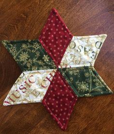 Christmas Quilted Star Candle Mat Red Green and White by seaquilt quiltedtablerunners Christmas Patchwork, Christmas Sewing, Noel Christmas, Christmas Ornaments, Green Christmas, Christmas Quilting, Christmas Coasters, Coastal Christmas, Fabric Crafts