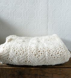 Gorgeous vintage ivory crocheted blanket. $40.00, via Etsy.  SOLD