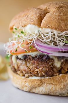 """THE Veggie Burger"" topped with Jack Cheese on Toasted Wheat Bun with Creamy Lemon-Garlic Mayo"