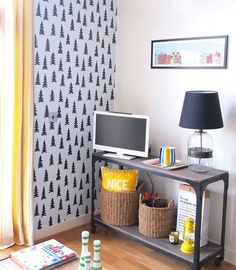 Temporary wallpaper is a great solution for rentals. And there are so many cool modern designs available now, like this adorable tree print.