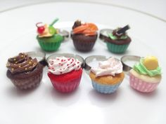This is the ultimate cupcake ring collection, theres 7 different flavors, one for each day of the week :) This are the flavors -Cherry Limeade -Orange and chocolate -Mint and chocolate -Angel Food -Vanilla -Chocolate -Red Velvet *This listing is for one ring, choose your favorites :) Please check out the measurements: 3/4 inch tall 1/2 inch wide  (This rings come with a surgical steel adjustable ring base, totally hypoallergenic and cadmium free, ideal for sensitive skins)  Its a nice…