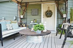 For an outdoor living room that won't mind weathering the elements, flip over a galvanized tub and top it with a thrifted table top.