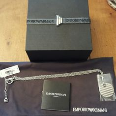 """❤ SALE ❤ Emp Armani medallion necklace ❌NOT ACCEPTING OFFERS ON THIS❌ Brand new with box and pouch 100% authentic  16"""" double chain, medallion measures a little over 1"""" diameter  One side has rows of cryatals, other side has stripes  Retails for $140 Have bracelet on separate listing NO TRADES NO LOWBALL OFFERS Emporio Armani Jewelry Necklaces"""
