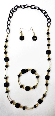 Juego de collar, pulsera y aretes con piedra negra, cadena de nylon negra. $580