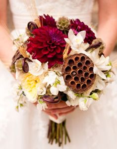 Gorgeous colors for fall, dark red dahlias, scabiosa pods, replace the big brown pod with a sunflower.