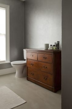 William Smalley flat in Bloomsbury, silver bathroom, Presbyterian Victorian chest of drawers  Remodelista