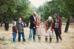 This is a fun use of framing and depth of field with the trees.  I also like how the different family members are doing different things to show of personalities!