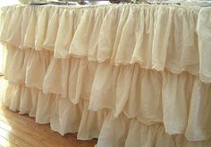 really want to make something like this...ruffled table cloth to the ground. love!