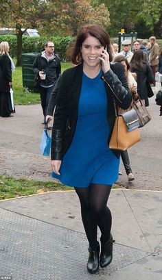 Princess Eudenie.Trendy: The New Yorker, who returned to home ground this week, looked stylish in a black jacket with leather sleeves as she chatted on the phone  Read more: http://www.dailymail.co.uk/femail/article-2792449/princess-eugenie-pretty-blue-rubs-shoulders-tamara-ecclestone-grayson-perry-art-show.html#ixzz3G8MRQQfb  Follow us: @MailOnline on Twitter | DailyMail on Facebook