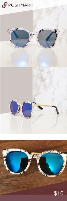 Marble Sunnies White and black marble plastic frames in a wayfarer style with blue mirrored lenses and shiny gold arms. 100% UV400 protection. These have never been worn. **Upon arrival in the mail there was a small scratch on left lens. Can still see through them perfectly fine, can't even notice the small marking** Accessories Sunglasses