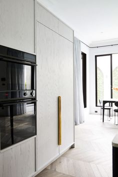 While the DishDrawer™ and Column Refrigerators and Freezer are seamlessly integrated within the pale timber cabinetry, the only appliances that are visible are Fisher & Paykel's signature all-black ovens, which echo the black accents used throughout the space and ensure that no metallic finishes on the oven interrupt the design intent. Architecture by Biasol. Photography by Armelle Habib. #modernarchitecture #exteriorarchitecture #dreamhouse
