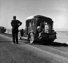 Dorothea LANGE :: March 1937 :: Car of Oakie family laden with baggage, stalled on desolate track of highway in desert in southern California.