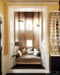 """Decorator Jean-Louis Deniot restores splendor to a neglected Paris apartment - """"A nook in the dining room contains velvet-upholstered seating, a floor lamp by Deniot, and Roman shades of a Jagtar silk."""""""