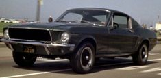 Bullitt--1968 Ford Mustang 390 Fastback in Highland Green, modified by Max Balchowsky:  The stunt drivers of the Dodge Charger 440s that the bad guys drove had to back off during chase scenes to not easily pull away from the Mustangs. McQueen still looked cooler.