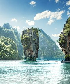 Thailand outdoor water tree mountain Nature geographical feature landform body of water Lake bay Sea River rock Coast tropics cliff Lagoon terrain Island national park islet surrounded day hillside