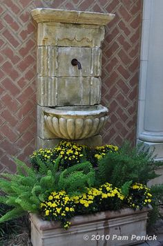 Google Image Result for http://www.penick.net/digging/images/2010_10_16_JonesGarden/Wall_fountain_w_mums.JPG