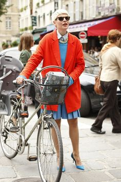 Bicycles as accessories and contrast brights in #Paris WGSN Street Shot, Paris Mens Fashion Week, Spring/Summer 2014
