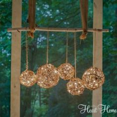 Easy DIY Outdoor Chandelier - All Things Heart and Home - DIY: How to Create Rustic Outdoor Lighting – using string lights and grapevine balls. This is an easy and clever way to add lighting to a porch – via All Things Heart and Home Backyard Lighting, Porch Lighting, Outdoor Lighting, Lighting Ideas, Wall Lighting, Exterior Lighting, Landscape Lighting, Lighting Design, Pendant Lighting
