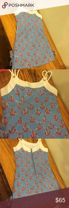 Lilly Pulitzer Anchors Away Delia dress girls 7 Lilly Pulitzer Anchors Away Delia dress girls 7.  Beautiful dress with rope detail straps.  Exposed zipper and signature bows at sides.  Bright fun print in excellent condition Lilly Pulitzer Dresses Casual