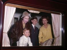 Queen Elizabeth II with Princess Margaret, Prince Charles and Prince Andrew in the royal train en route for Christmas at Sandringham.