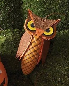 These woodland favors are pinecone boxes disguised as birds of prey. The textured ridges resemble feathers, and crepe-paper embellishments finish the owl's menacing look.Print the Owl Treat Box Template Halloween Owl, Halloween Treat Bags, Holidays Halloween, Halloween Projects, Acorn Crafts, Pine Cone Crafts, Nature Crafts, Fall Crafts, Diy Crafts