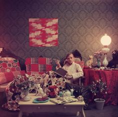 Truman Capote in his apartment in Brooklyn Heights, New York City, 1958.  Photo by Slim Aarons.