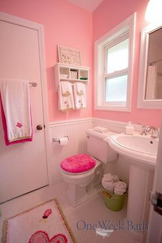 The One Week Bath team transformed this Jack and Jill into a girl-themed pink and white bathroom. This renovation includes pink wall paint and an old-fashioned pedestal sink, along with several additional details that make it perfect for a little girl. Pink Bathroom Decor, Bathroom Styling, White Bathroom, Boho Bathroom, Bathroom Interior, Bathroom Ideas, Narrow Bathroom, Modern Bathroom, Minimalist Bathroom
