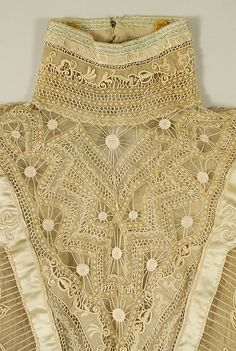 Close up of details on this gorgeous antique blouse. high neck, smocking, embroidery, lace insertions. Embellishments, decoration, trimmings.