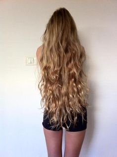great length! pretty, super long curly hair.
