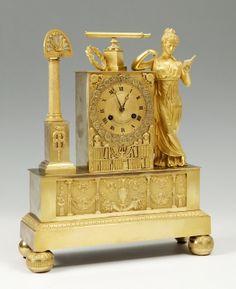 Reloj de sobremesa Imperio, hacia 1804-05.Bronce dorado al mercurio.
