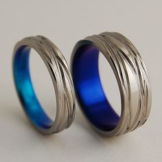 Titanium Wedding Rings , The Sphinx Bands in Nightfall and New Beginning Blue. $140.00, via Etsy.
