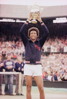 Arthur Ashe holds the Gentlemen's Singles Trophy after defeating fellow American Jimmy Conners (6-1, 6-1, 5-7, 6-4) in the final of the men's singles championship at the All England Lawn Tennis Championship in Wimbledon, England, July 5, 1975. (AP Photo) #therulesoftennis #LearnAboutTennis