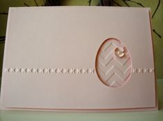 handmade Easter card from penguinstamper ... monochromatic pink ... clean and simple ... negative die cut space in the shape of an egg ... backed in same paper embossed with large chevrons ... one lie of simple embossing across the front ... sweet card ... Stampin'Up!