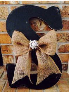 A personal favorite from my Etsy shop https://www.etsy.com/listing/229009937/initial-with-burlap-bow