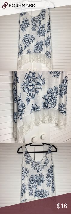 NWOT Suzy Shier Floral Tank w/ Lace Bottom NWOT Suzy Shier Blue/White Floral Tank w/ Lace Bottom. 100% Rayon Suzy Shier Tops Tank Tops