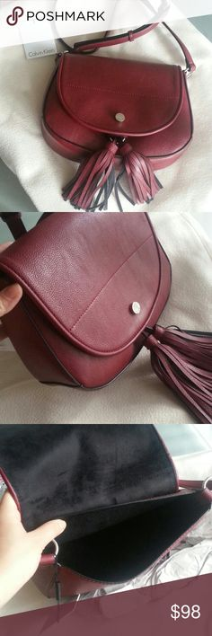 "NWT Calvin Klein Saddle Bag Burgandy color Brand new with tag , Retail $128 Adjustable crossbody 8.5"" x 10"" x 3"" Calvin Klein Bags Crossbody Bags"