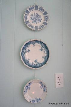 A Pocketful of Blue blue and white plates hung together