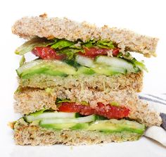 The Ultimate Vegan Sandwich: 4 pieces of bread sliced, ¼ cup hummus, ½ avocado thinly sliced, ½ cucumber sliced, 1 tomato sliced, 1 Tbsp olive oil divided, Dash of salt, Dash of lemon pepper, Handful of lettuce (can sub sprouts, spinach, arugula, etc.)