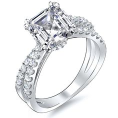 This well-designed 1.35 Ct. diamond engagement ring features a charming 0.75 Ct. Asscher cut diamond with D color grade and VS2 clarity. Additional 0.60 Ct. Round cut diamonds are set U pave along the crossover split shank showcasing and complementing the color and clarity of the center gem.