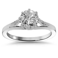 This lovely diamond engagement ring is crafted in lustrous Platinum. The center is prong set with one 0.65 carat round cut diamond and the sides are detailed with small pave set round cut diamonds which total to 0.05 carats. The center measures to 1/4 Inches in width and the band measures to 1/8 Inches in width. Weighing approximately 3 grams, this elegant diamond engagement ring is an ideal gift for that special someone. $2,313.00