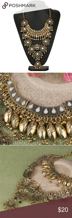 "Turkish Boho Statement Necklace Wore once to a Christmas party and got TONS of compliments. Selling bc my style has changed and I'm planning on moving soon. Necklace length is 17"", extension length 3.5"", weight is approximately 0.3lbs. I usually don't wear necklaces, and I did not find this heavy at all. Only flaw is a slight tarnish on the clasp and surrounding links in the extension. Open to reasonable offers. Jewelry Necklaces"